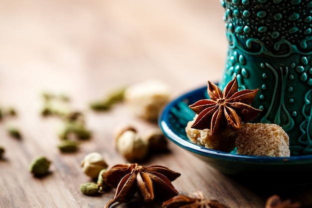 Hot drink with spices in authentic cup Premium Photo