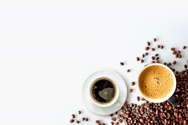 Hot espresso and coffee bean on white table Premium Photo