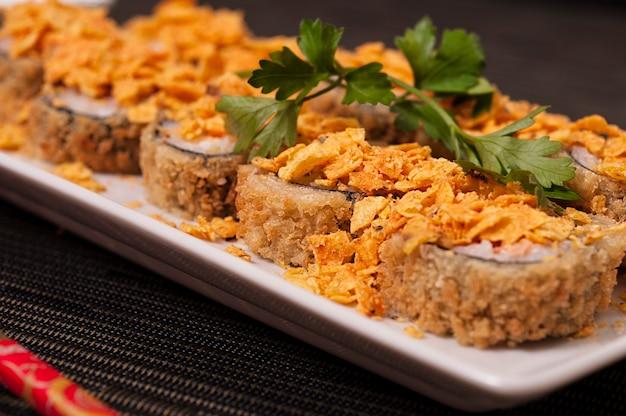 Hot harumaki sushi japanese food meal and rice, refreshing asian food, sashimi, sushi and veggies Premium Photo