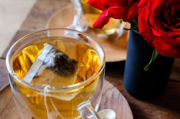 The hot lavender tea in glass serve with wooden spoon & saucer Premium Photo
