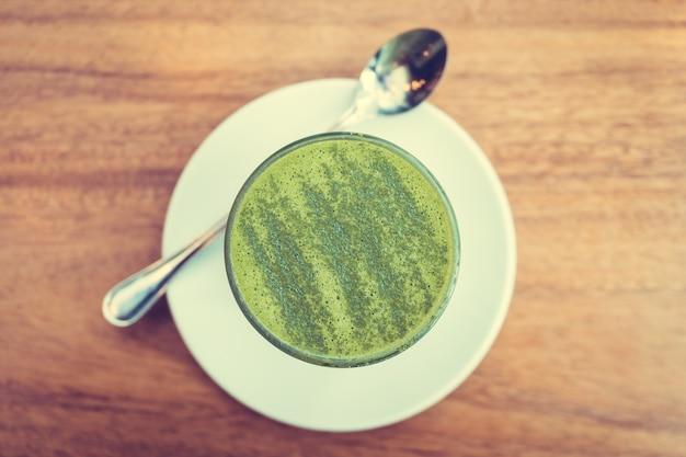 Hot matcha green tea latte cup Free Photo