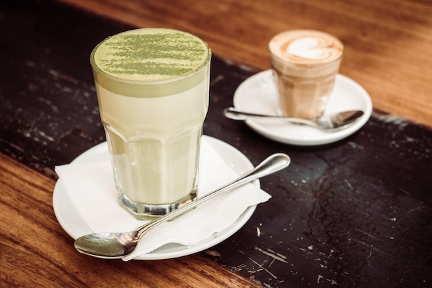 Hot matcha green tea latte cup Free Photo