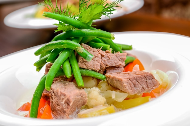 Hot salad with meat, vegetables and beans Premium Photo