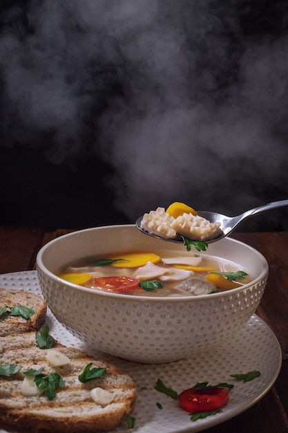Hot soup khash with steam, caucasian cuisine | Premium Photo