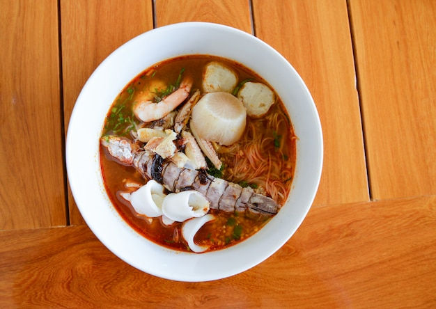 Hot and spicy noodle seafood soup bowl Premium Photo