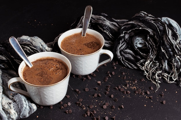 Hot sweet chocolate in white cups Free Photo