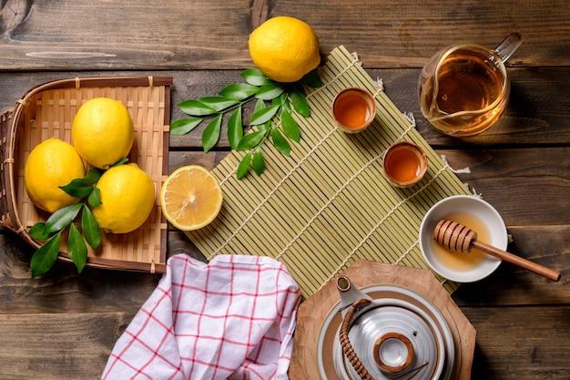 Hot tea with lemon and natural honey, Premium Photo