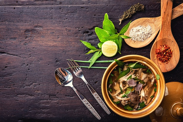 Hot vegetable soup with chicken, puree, herbs, pumpkin seeds for lunch fillet in a bowl over dark rustic wooden background top view Premium Photo