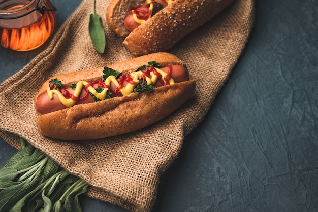 Hotdog and sausage with sage vegetables Premium Photo