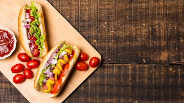 Hotdogs on cutboard with copy space Free Photo