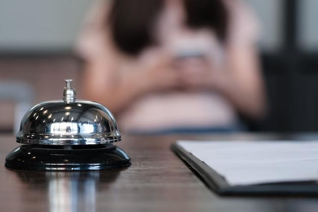 Hotel reception counter desk with service bell. Premium Photo