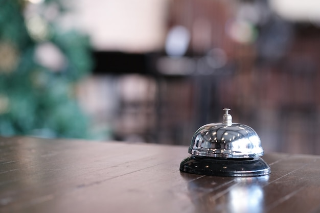 Hotel reception counter desk with service bell. Premium Photo