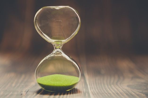 Hourglass as a concept of past time, lost time or completed cases. Premium Photo