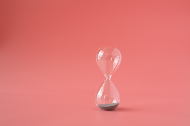 Hourglass sand time past flow concept Premium Photo