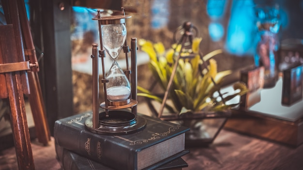 Hourglass sandglass with compass Premium Photo