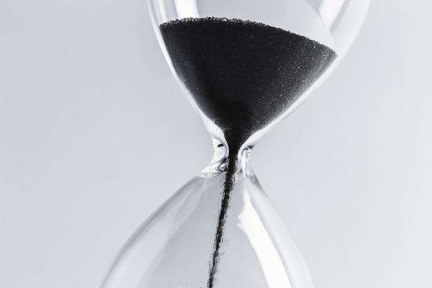 Hourglass on table Premium Photo