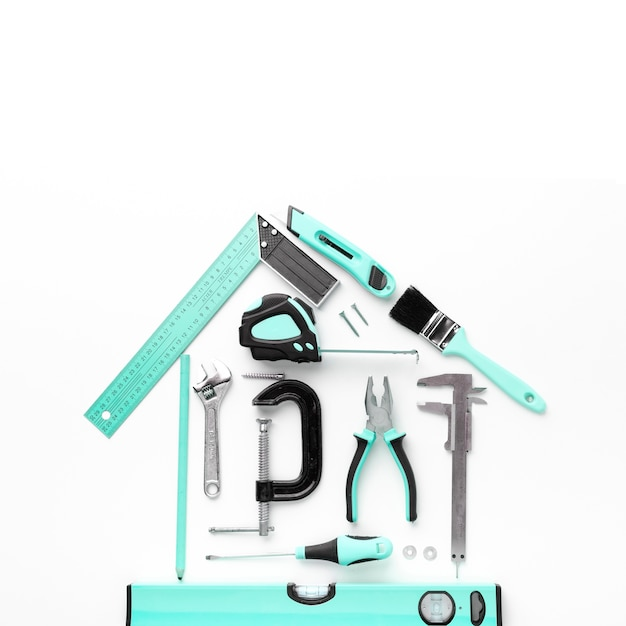 House arrangement from blue repair tools top view Free Photo