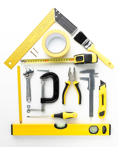 House arrangement from yellow repair tools top view Free Photo