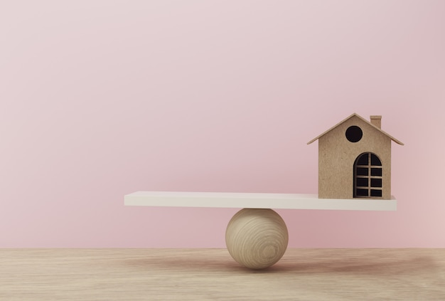 House a balance scale in equal position on wooden table and pink background Premium Photo