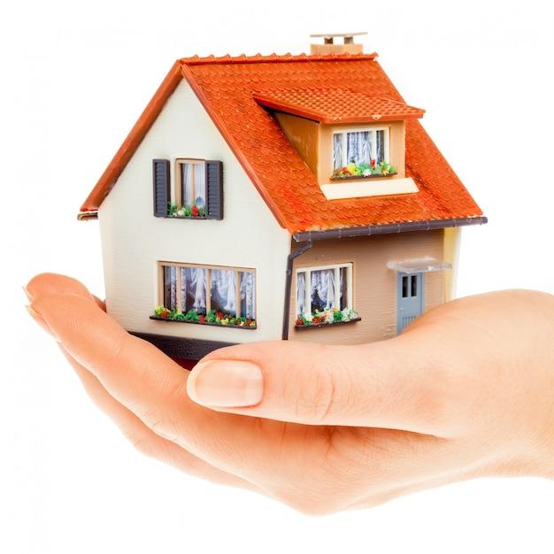 House in human hands Premium Photo