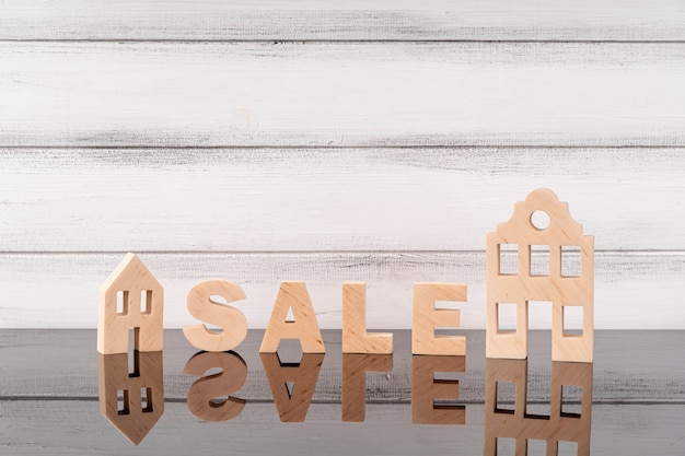 House miniature and sale lettering Free Photo
