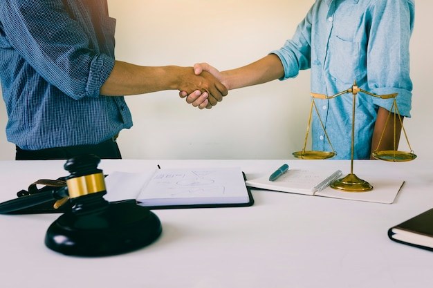 House owner shake hands with lawyer. successful housing law plan Premium Photo