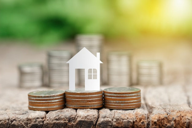 House paper on coins stack for saving to buy a house Premium Photo