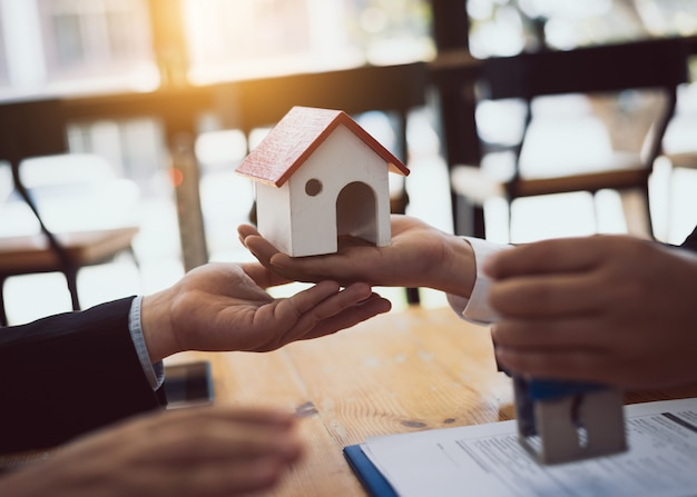 House real estate sell agent reviews the documents that have been approved for the home buyer loan. Premium Photo