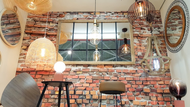 House shop brick red wall retro mirror with different modern chandeliers metal shade pendant decoration Premium Photo