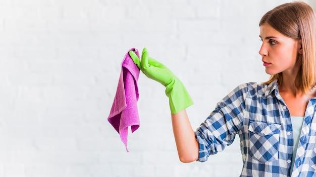 Housekeeper holding a rag Free Photo
