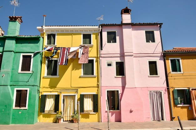Houses in burano, venice, italy.  colorful concept, yellow, pink and blue Premium Photo