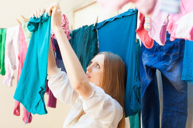 Housewife drying clothes on clothes-line Free Photo
