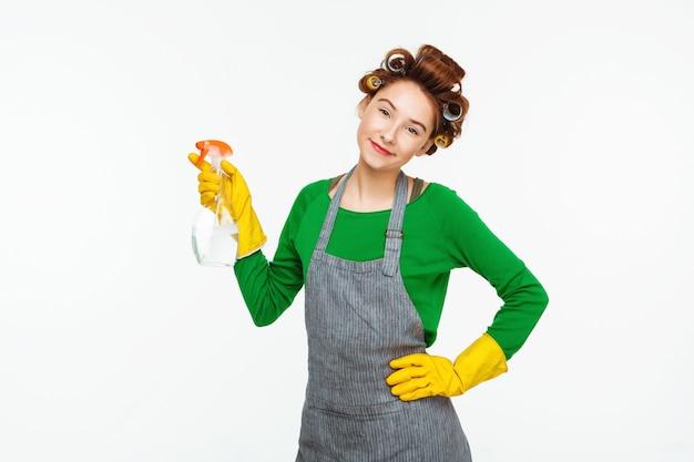 Домохозяйка с яркой бутылкой в зеленой резине Бесплатные Фотографии