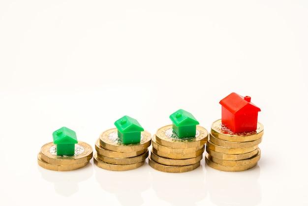 Housing estate concept with coins Premium Photo