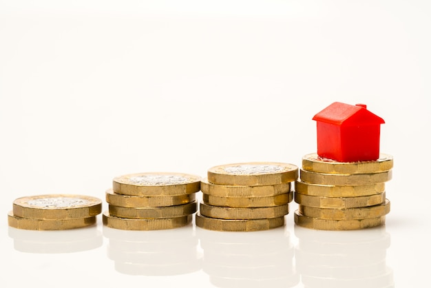 Housing estate   with coins Premium Photo