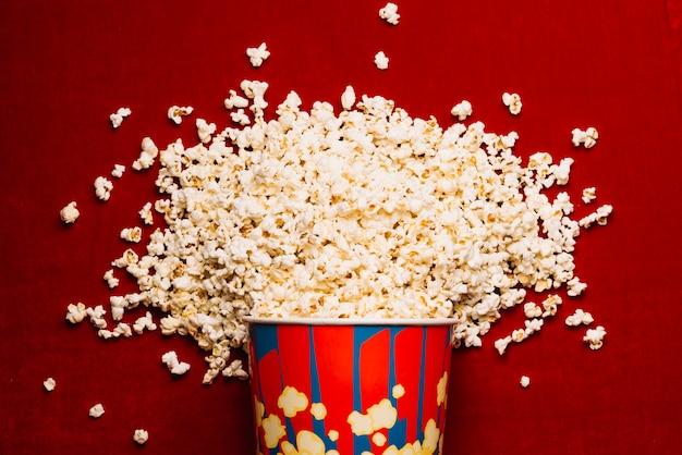 Huge pile of popcorn on cinema floor Premium Photo