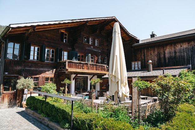 Huge swiss hotel with outdoor restaurant Free Photo
