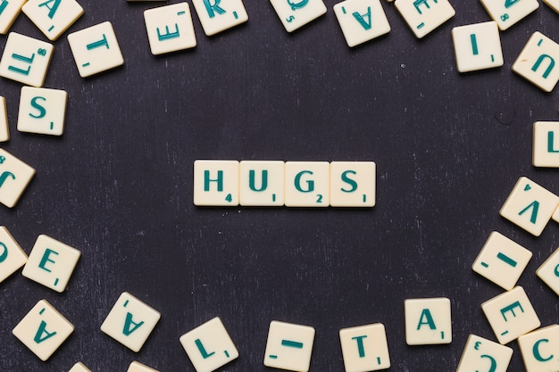 Hugs text arranged in a row over black background Free Photo