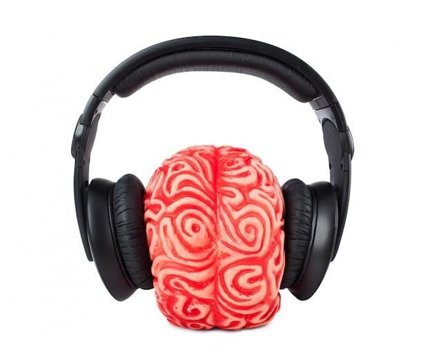 Human brain rubber with headphones Premium Photo