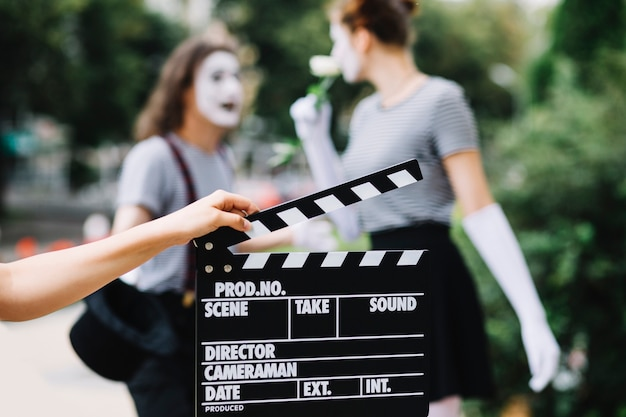 Human hand holding clapperboard Free Photo