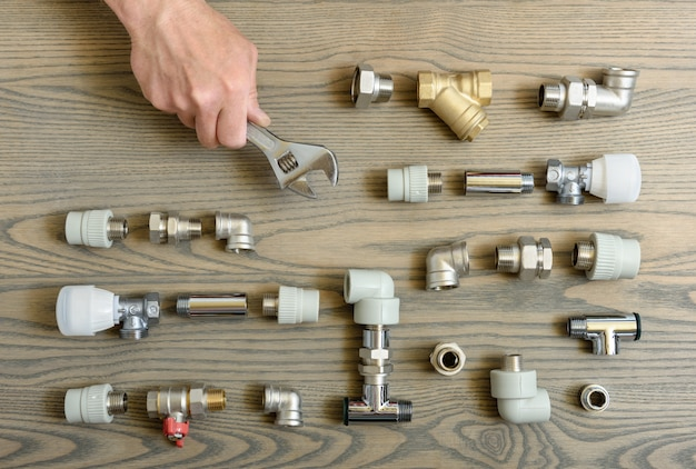 A human hand is holding the adjustable wrenches. Premium Photo