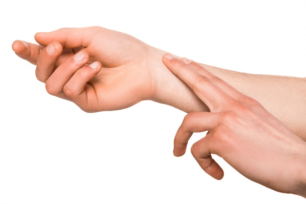 Human hand measuring arm pulse Premium Photo