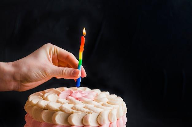Fabulous Human Hand Putting Candle On Cake Free Photo Personalised Birthday Cards Petedlily Jamesorg