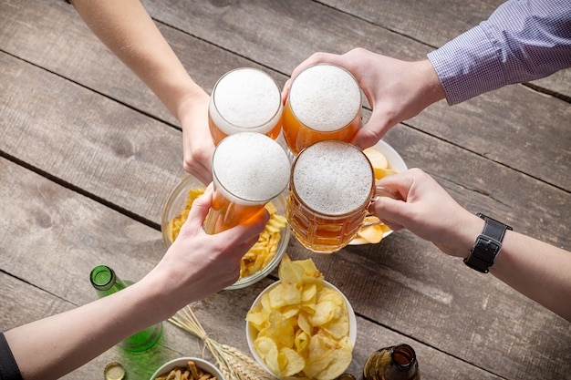 Human hands and glasses of beer Premium Photo