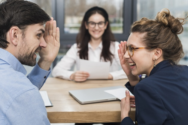 Human resources people talking about a woman who's attending a job interview Free Photo