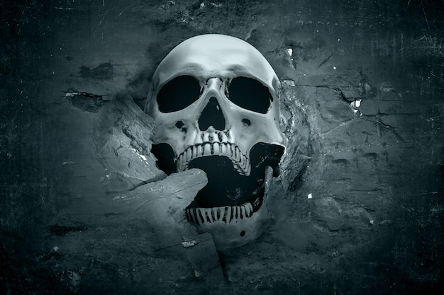 Human skull showing from a cracked wall Premium Photo