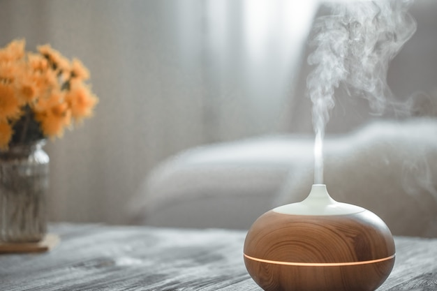 Humidifier on the table in the living room. Free Photo