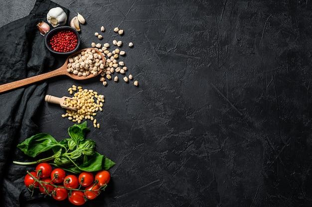 Hummus ingredients, garlic, chickpeas, pine nuts, basil, pepper. top view. copyspace background Premium Photo