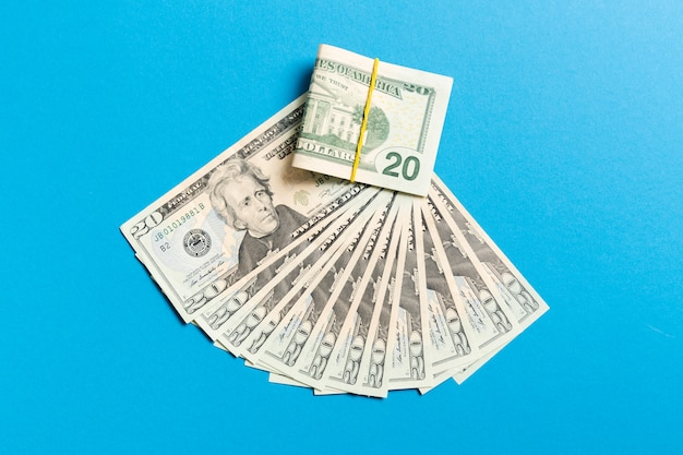 A hundred dollar currency fan close up, top view of business  on colored  with copyspace Premium Photo