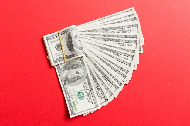 A hundred dollar currency fan close up, top view Premium Photo